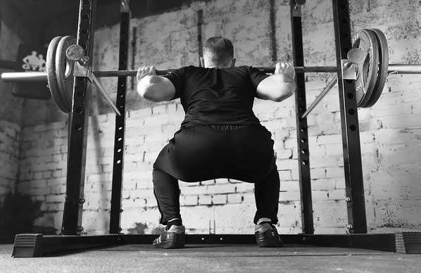 slowly-lower-yourself-to-do-the-squat